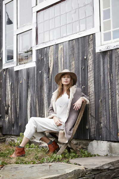 PAS DE CALAIS Mouton Shearling Long Coat / PAS DE CALAIS Swiss Dot Gauze Shirt / PAS DE CALAIS Drop-Rise Trousers / EUGENIA KIM Georgina Wide-Brim Fedora / FEATHERED SOUL Locket On Cable Chain / ESQUIVEL Distressed Jill Ankle Boots